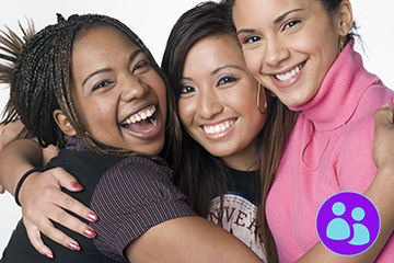 Portrait of three teenage mixed race girls